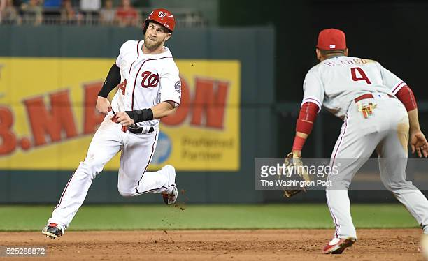 Washington Nationals right fielder Bryce Harper advances to third on an RBI single by Ryan Zimmerman against the Philadelphia Phillies on April 26...