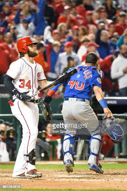Washington Nationals right fielder Bryce Harper walks away after striking out to end the game as Chicago Cubs catcher Willson Contreras celebrates...