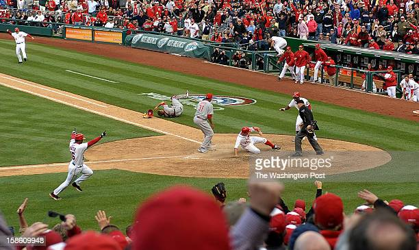 WASHINGTON DC APRIL Washington Nationals' Ryan Zimmerman slides in to home plate winning the game in the tenth inning after a wild pitch by...