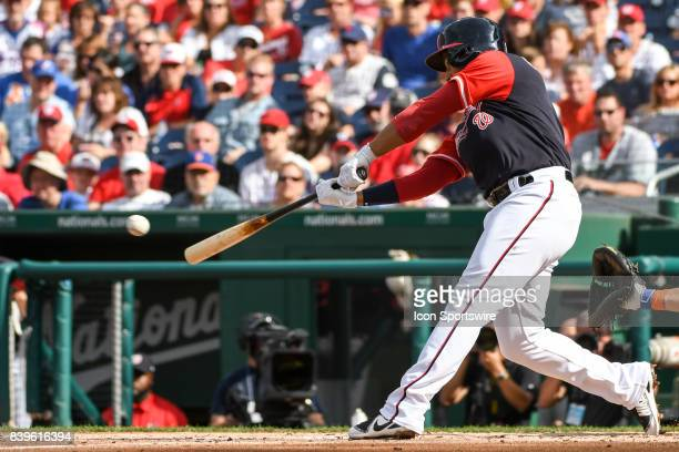 Washington Nationals second baseman Adrian Sanchez hits a two run RBI single in the first inning during an MLB game between the New York Mets and the...