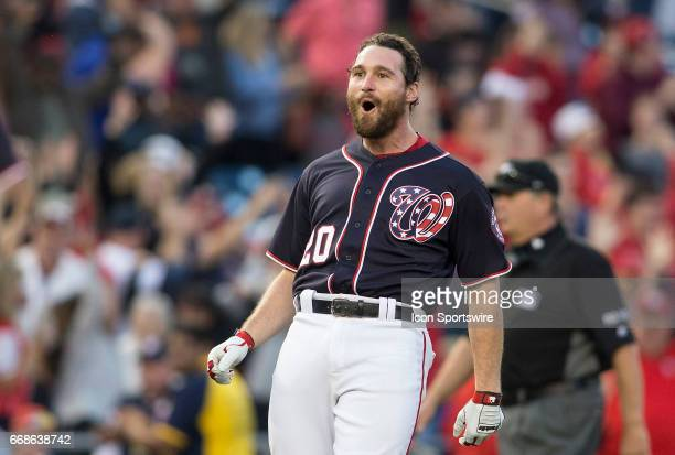 Washington Nationals second baseman Daniel Murphy celebrates his double that knocked in the winning run in the tenth inning during a MLB game between...