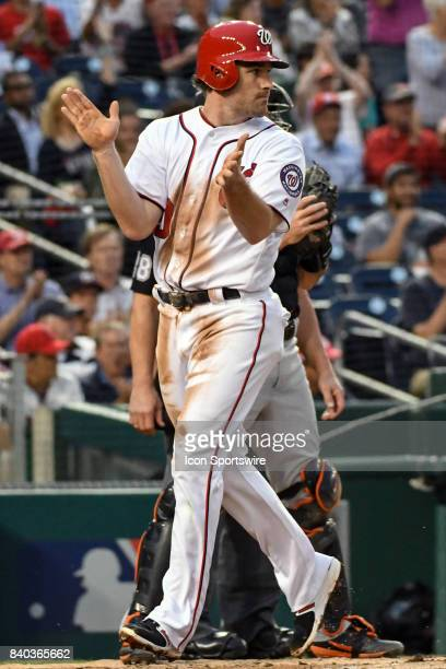 Washington Nationals second baseman Daniel Murphy claps his hands after scoring in the first inning during an MLB game between the Miami Marlins and...