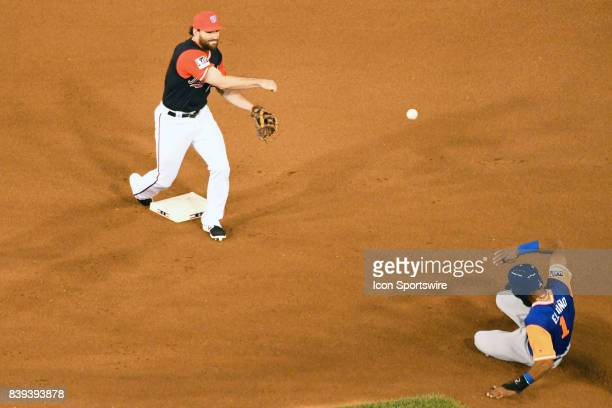 Washington Nationals second baseman Daniel Murphy completes a double play retiringNew York Mets shortstop Amed Rosario at second base during an MLB...