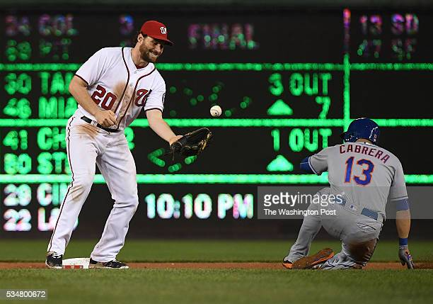 Washington Nationals second baseman Daniel Murphy gets New York Mets shortstop Asdrubal Cabrera out at second but bobbles the ball and fails to turn...