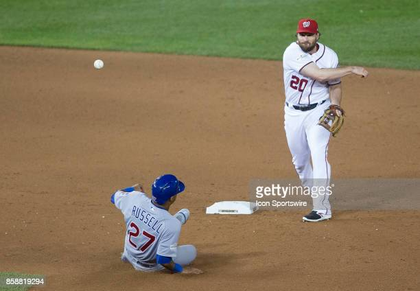 Washington Nationals second baseman Daniel Murphy has Chicago Cubs shortstop Addison Russell out at second base on a double play to end the game...