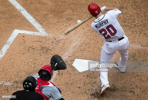 Washington Nationals second baseman Daniel Murphy hits a single for a RBI in the sixth inning during a MLB game between the Washington Nationals and...