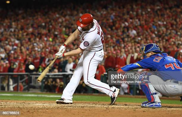 Washington Nationals second baseman Daniel Murphy hits an RBI double in the sixth inning against the Chicago Cubs during game five of the NLDS at...