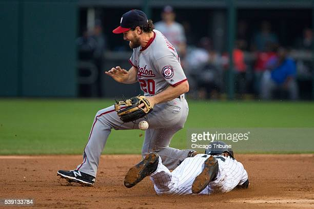 Washington Nationals second baseman Daniel Murphy misses the ball as the Chicago White Sox's Austin Jackson dives back to second base during the...