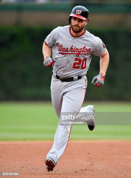 Washington Nationals second baseman Daniel Murphy rounds second base after hitting a home run during the game between the Washington Nationals and...