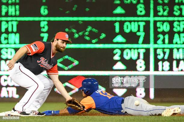 Washington Nationals second baseman Daniel Murphy takes the late throw on a steal by New York Mets center fielder Juan Lagares in the ninth inning...