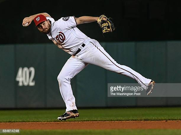 Washington Nationals second baseman Daniel Murphy throws out New York Mets shortstop Asdrubal Cabrera in the eighth inning of the game between the...