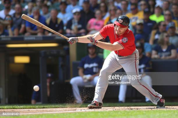 Washington Nationals second baseman Daniel Murphy watches a hit ball during a game between the Milwaukee Brewers and Washington Nationals on...