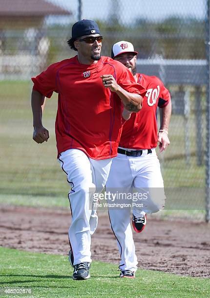 Washington Nationals shortstop Ian Desmond and outfielder Kevin Frandsen sprint on the warning track during spring training workouts on March 3 2015...