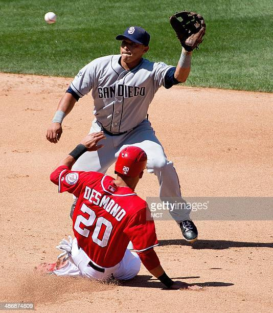 Washington Nationals shortstop Ian Desmond steals second base before San Diego Padres second baseman Jedd Gyorko can apply the tag during the seventh...