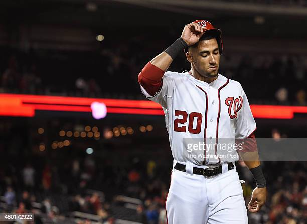Washington Nationals shortstop Ian Desmond walks off the field after striking out during the game between the Washington Nationals and the San Diego...
