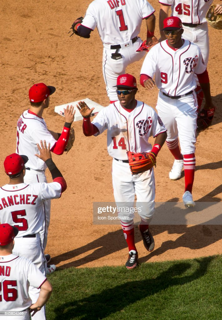 Washington Nationals shortstop Trea Turner (7) and center fielder Victor Robles (14) hi-five at the end of a MLB game between the Washington Nationals and the Philadelphia Phillies on September 10, 2017 at Nationals Park, in Washington DC.
