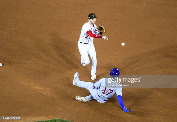 Washington Nationals shortstop Trea Turner completes a double play forcing Chicago Cubs third baseman Kris Bryant out in the fourth inning on May 18...