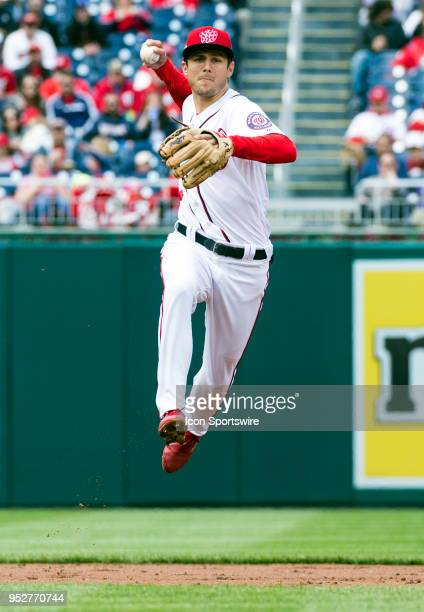 Washington Nationals shortstop Trea Turner makes a throw to first for an out in the second inning during a MLB game between the Washington Nationals...