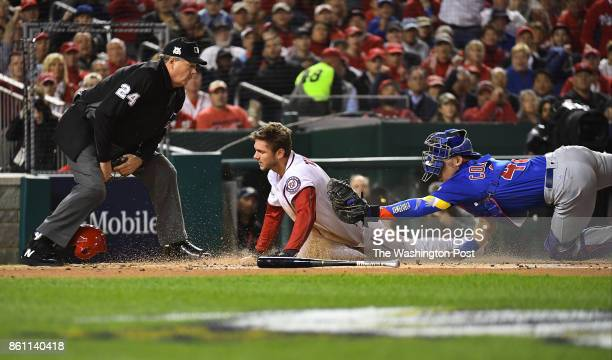 Washington Nationals shortstop Trea Turner tagged out at homes by Chicago Cubs catcher Willson Contreras in the fifth game of the NLDS at Nationals...