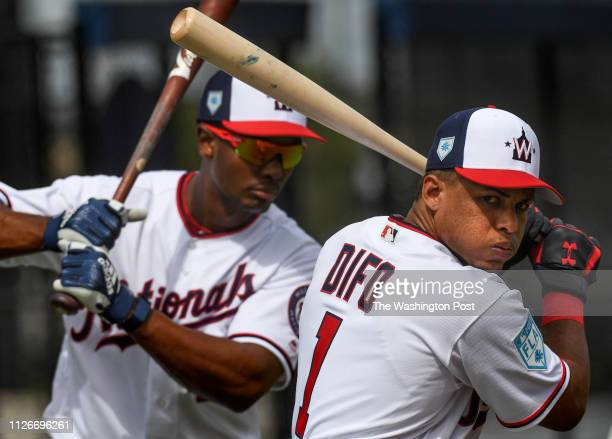 BEACH FL FEBRUARY Washington Nationals shortstop Wilmer Difo and Washington Nationals center fielder Michael Taylor warm up before taking batting...