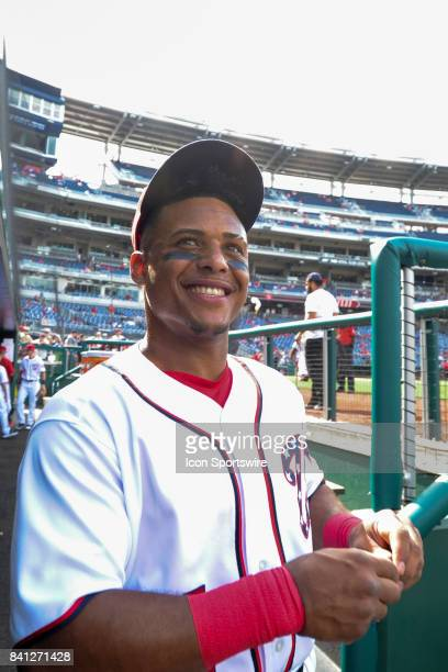 Washington Nationals shortstop Wilmer Difo smiles in the dugout prior to an MLB game between the Miami Marlins and the Washington Nationals on August...