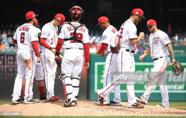 Washington Nationals starting pitcher AJ Cole leaves the mound after being pulled by manager Dave Martinez against the Atlanta Braves at Nationals...