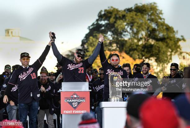 Washington Nationals starting pitcher Anibal Sanchez and Washington Nationals center fielder Gerardo Parra hold up the arm of Washington Nationals...