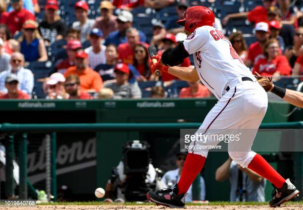 Washington Nationals starting pitcher Gio Gonzalez hits a sacrifice bunt in the third inning during the game between the Miami Marlins and the...
