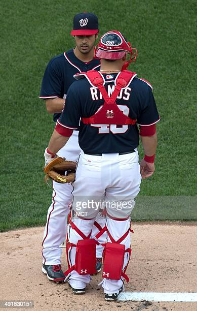 Washington Nationals starting pitcher Gio Gonzalez talks with Washington Nationals catcher Wilson Ramos on the mound during the first inning of their...