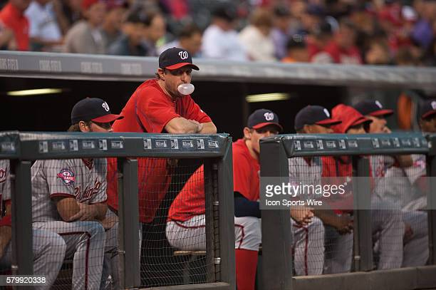 Washington Nationals starting pitcher Max Scherzer blows a bubble gum bubble in the dugout during a regular season Major League Baseball game between...
