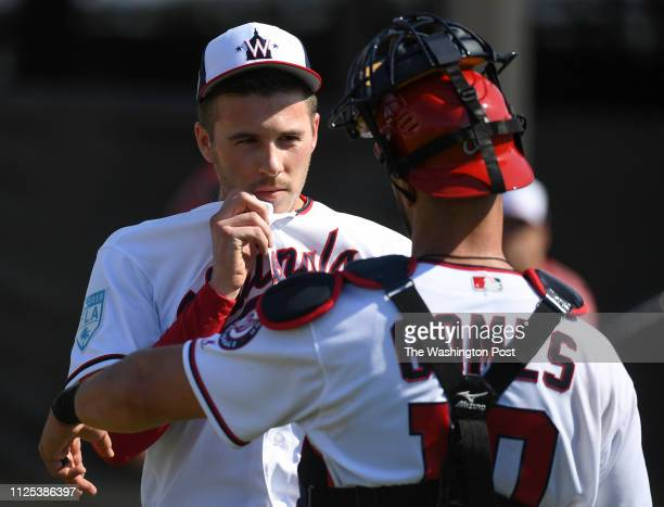 BEACH FL FEBRUARY Washington Nationals starting pitcher Patrick Corbin talks with catcher Yan Gomes after throwing a bullpen session during the...