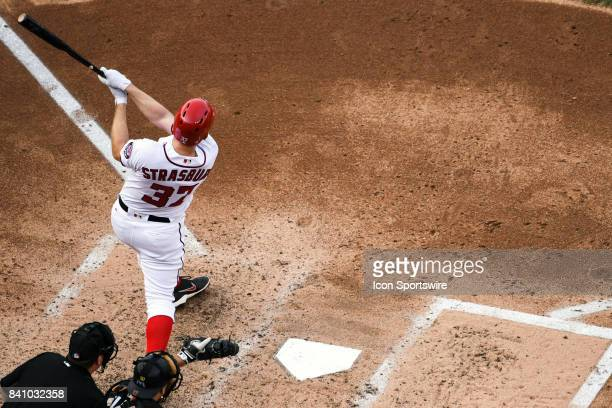 Washington Nationals starting pitcher Stephen Strasburg hits a solo home run in the fifth inning during an MLB game between the Miami Marlins and the...
