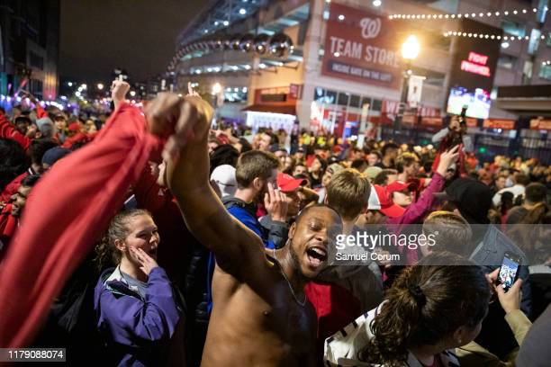 Washington Nationals stream into the streets outside of Nationals Park celebrating the Nationals World Series victory on October 30 2019 in...