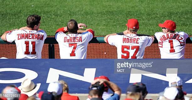Washington Nationals third baseman Ryan Zimmerman left fielder Mark DeRosa left fielder Tyler Moore and second baseman Stephen Lombardozzi watch the...