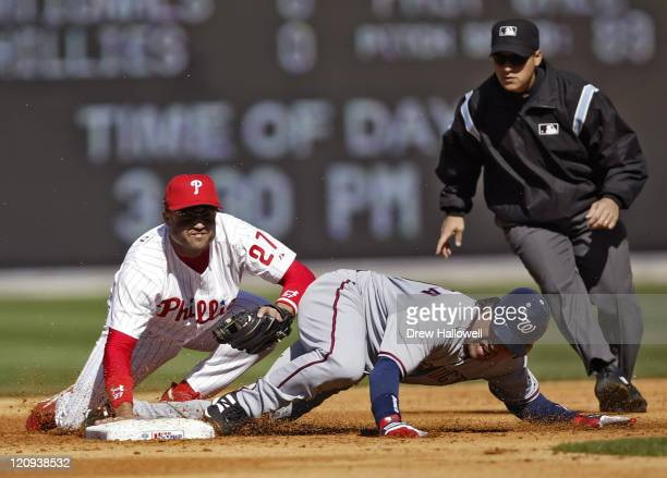 Washington Nationals third baseman Vinny Castilla is tagged out by Philadelphia Phillies second baseman Placido Polanco in game where the...
