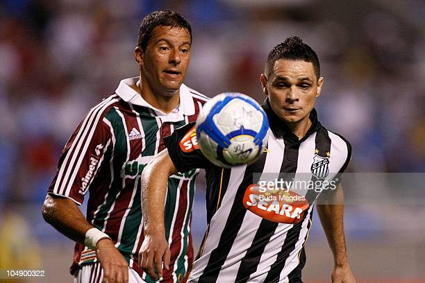 Washington of Fluminense struggles for the ball with Para of Santos during a match as part of Serie A at Engenhao Stadium on October 06, 2010 in Rio...
