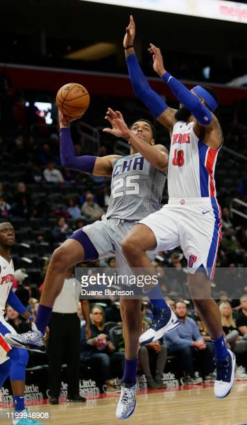 Washington of the Charlotte Hornets goes to the basket against Markieff Morris of the Detroit Pistons during the first half at Little Caesars Arena...