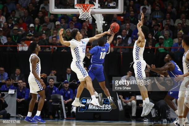 Washington of the Kentucky Wildcats blocks a shot by Wes Clark of the Buffalo Bulls during the first half in the second round of the 2018 NCAA Men's...