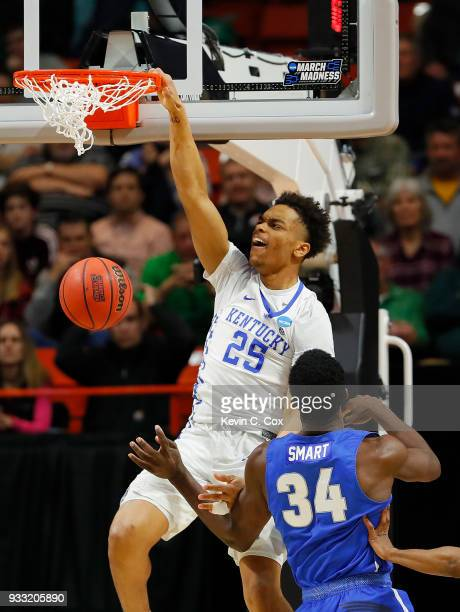 Washington of the Kentucky Wildcats dunks the ball during the first half against Ikenna Smart of the Buffalo Bulls in the second round of the 2018...