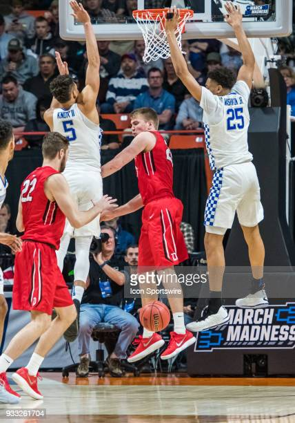 Washington of the Kentucky Wildcats puts a block on a lay up shot by G Jordan Watkins of the Davidson Wildcats during the NCAA Division I Men's...