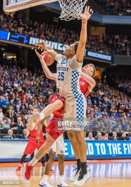 Washington of the Kentucky Wildcats thwarts a lay up attempt by F Peyton Aldridge of the Davidson Wildcats during the NCAA Division I Men's...