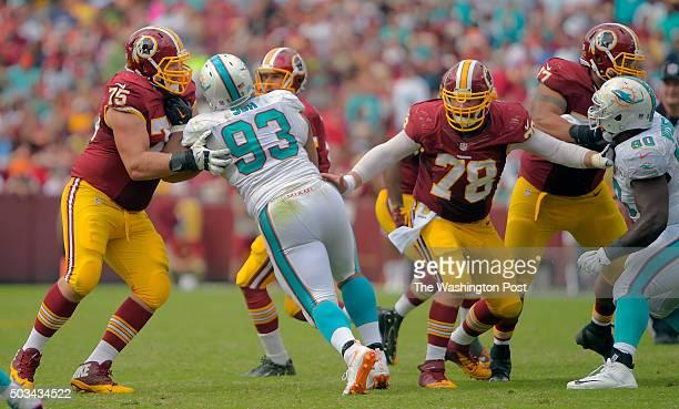 Washington offensive guard Brandon Scherff left blocks Miami defensive tackle Ndamukong Suh as Washington center Kory Lichtensteiger and Washington...