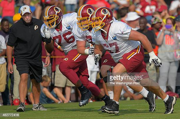 Washington Offensive Line Chris Foerster left watches offensive tackle Morgan Moses 2nd left offensive guard Spencer Long center and guard Josh...