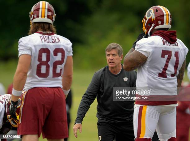 Washington offensive line coach Bill Callahan center instructs TE Logan Paulsen left and Trent Williams during the 2nd day of the Washington Redskins...