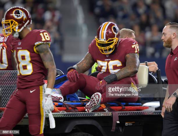 Washington offensive tackle Morgan Moses is carted off the field after an injury against the Dallas Cowboys as the Washington Redskins play the...