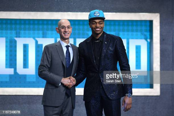 Washington poses with NBA Commissioner Adam Silver after being drafted with the 12th overall pick by the Charlotte Hornets during the 2019 NBA Draft...