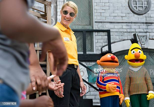 Washington Post reporter Andrea Sachs greets children lined up to visit Bert and Ernie at Sesame Place Thursday Aug4 2011 in Langhorne PA Andrea...