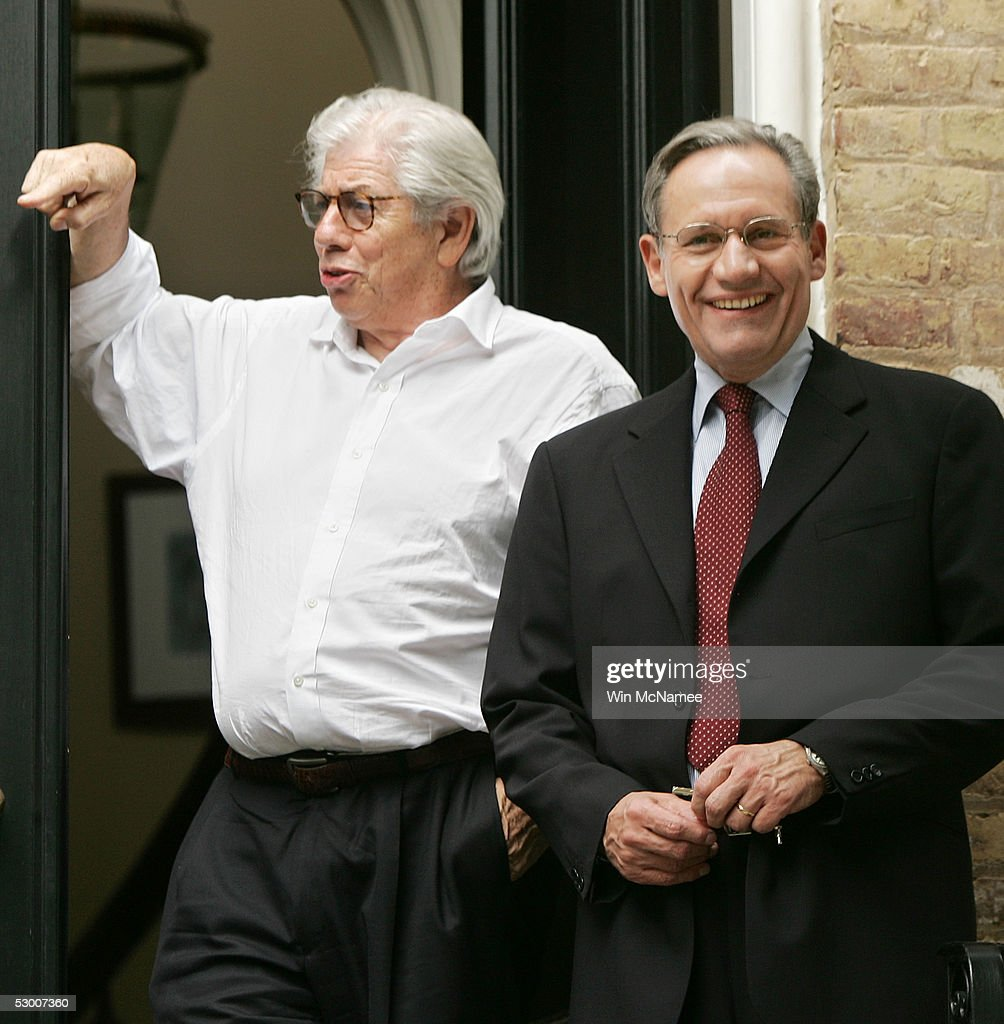 Washington Post reporter Bob Woodward (R) and former Washington Post reporter Carl Bernstein speak to members of the media from the steps of Woodward's house June 1, 2005 in the Georgetown neighborhood of Washington, DC. After 30 years of secrecy Woodward and Bernstein have confirmed former FBI Deputy Director Mark Felt was the 'Deep Throat' source who helped unravel the Watergate scandal and bring down President Richard Nixon.