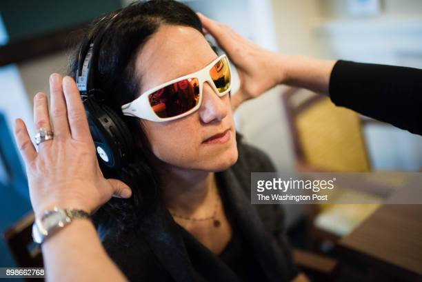Washington Post reporter Tara Bahrampour has glasses and headphones put on her in preparation for the training Employees of Brightview Senior Living...