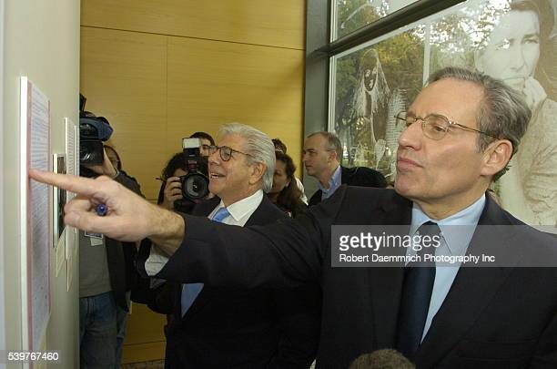 Washington Post reporters Carl Bernstein center and Bob Woodward right look at their Watergate papers on February 3 at the University of Texas at...